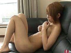 Lovely And Sexy Asian Nymph On The Couch Playing With Her Trimmed Snapper